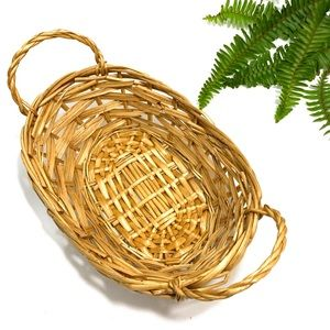 vintage small wicker catch all basket (w/ handles)